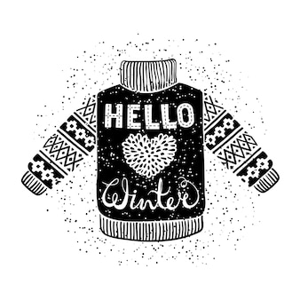 Hello winter text and knitted wool pullover with a heart.