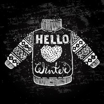Hello winter text and knitted wool sweater with a heart