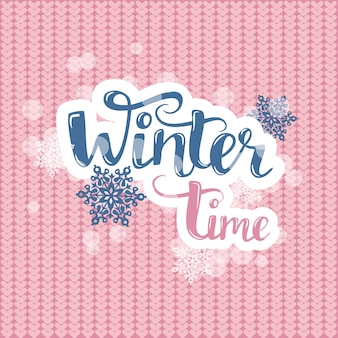 Hello winter text on pink knitting. vector brush lettering with snowflakes.