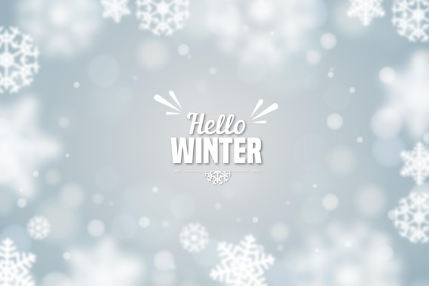 Hello winter with blurred snowflakes background
