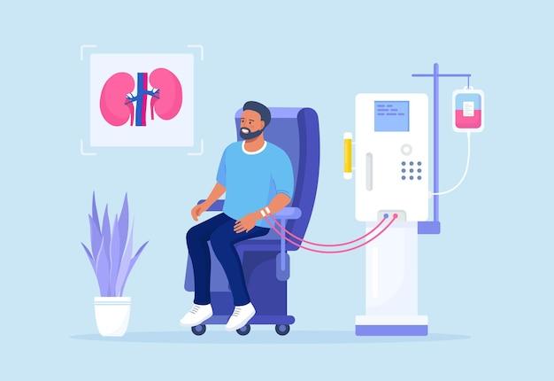 신부전 치료를 위한 혈액 투석 장비. 투석기를 통한 혈액 정화 및 수혈. 환자가 의자에 앉아 신장병 치료를 받고 있다