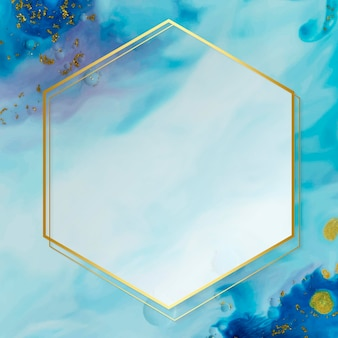 Hexagon gold frame on abstract blue watercolor