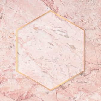 Hexagon gold frame on pink marble background vector