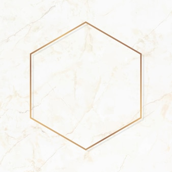 Hexagon gold frame on white marble background vector