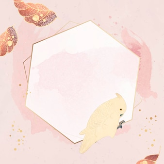 Hexagonal gold frame with a macaw and leaf motifs on a pastel pink background