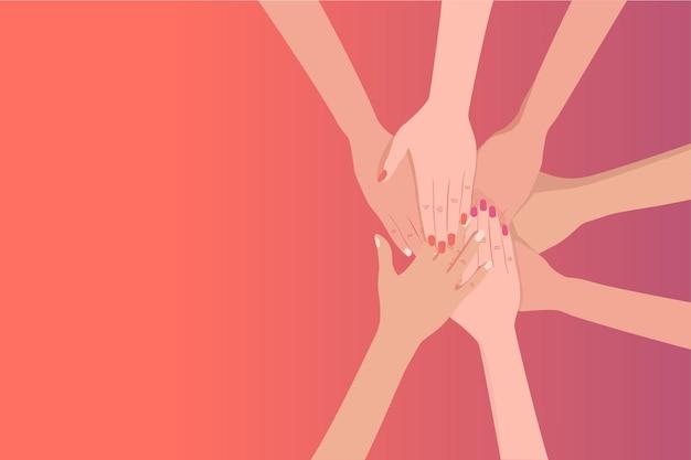 Высокий угол обзора людей, складывающих руки друг над другом.