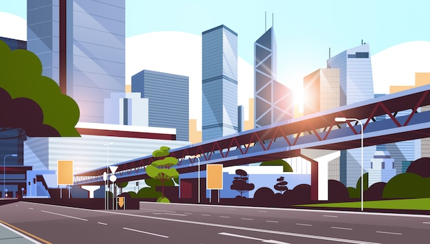Highway road to city skyline with modern skyscrapers and subway