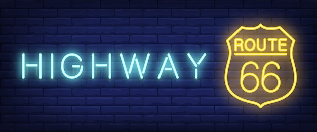 Highway, route sixty six neon text on shield sign