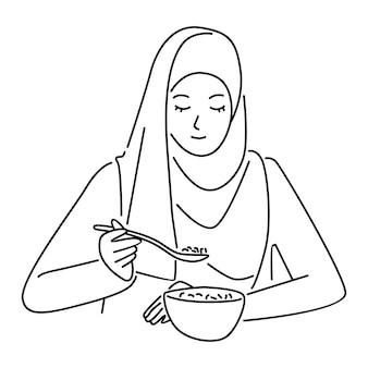 ヒジャーブの女性の朝食