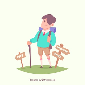 Hiker next to direction signs