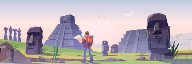 Uomo escursionista sull'isola di pasqua con antiche piramidi maya e statua moai
