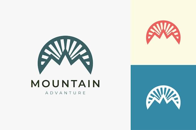 Hiking or climbing logo template in modern mountain shape