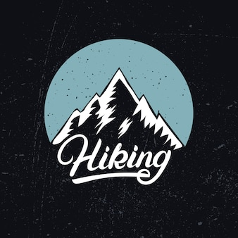 Hiking hand written lettering with mountain
