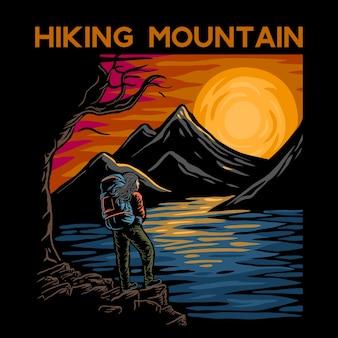 背景の川、山、湖のあるハイキング山。