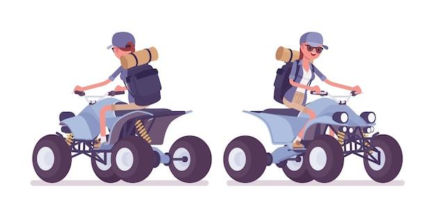 Hiking woman riding atv quad bike
