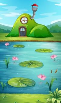 池の隣の丘の家