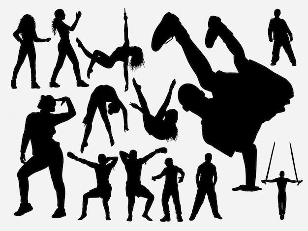 Силуэт танца хип-хопа и акробата