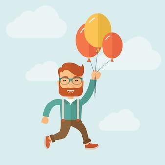 流行に敏感な男はヘリウム風船で飛んでいます。