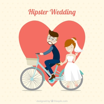 Hipster wedding couple with bicycle