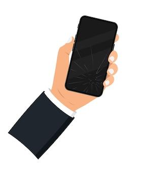 Держит в руке черный смартфон с разбитым дисплеем. сломанный экран мобильного телефона. смартфон с сенсорным экраном с разбитым экраном. треснувший дисплей смартфона. ремонт экрана мобильного телефона