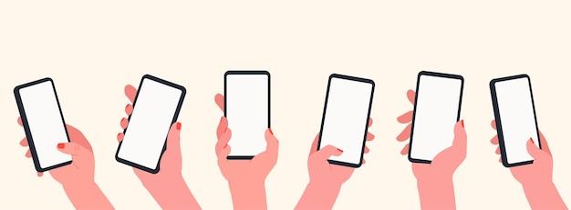 手に電話を持っています。空白のスマートフォン画面と手のセット。コミュニケーションとソーシャルメディアの概念、学習、タッチスクリーンデバイス上のアプリ。