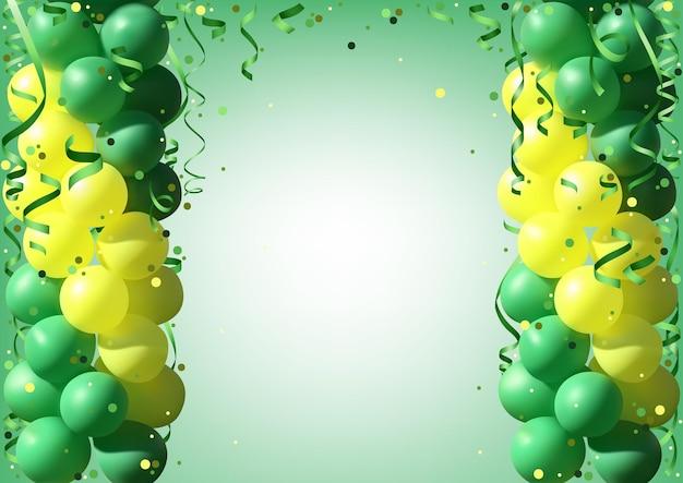 녹색과 노란색 파티 풍선과 함께 휴일 배경