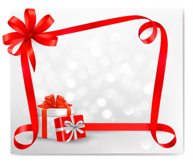 Праздничный фон с красным подарочным бантом с подарочными коробками