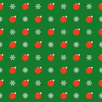 明るい漫画のクリスマスボールと雪片と休日の明るい色のパターンの背景