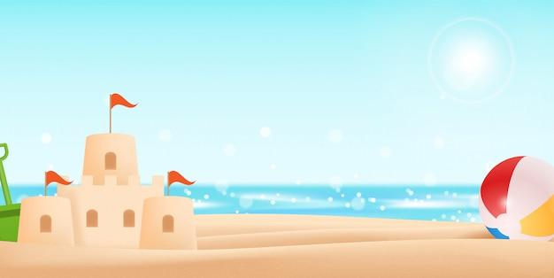 砂の城とボールで海辺の休日
