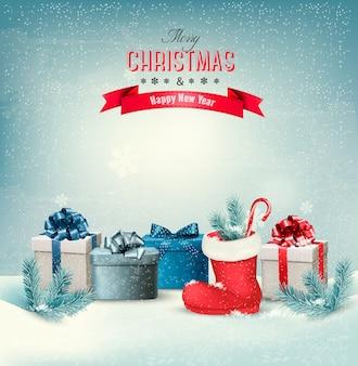 ギフトボックスとブーツとホリデークリスマスの背景。