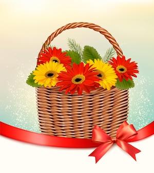 バスケットと赤いリボンの色とりどりの花と休日のイースターの背景。ベクター