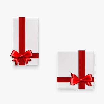Праздничный подарок две белые коробки с красным атласным бантом вид сверху реалистичный 3d векторный объект атласная шелковая лента