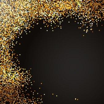 黒の背景にホリデーキラキラデコレーションゴールドの紙吹雪のスプレークリスマスキラキラ効果