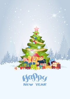 Holiday greeting card christmas tree over snowy winter forest happy new year concept