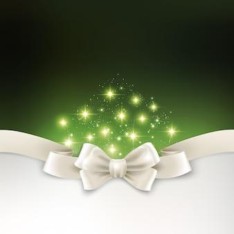 白い絹の弓と休日の光のクリスマスの背景