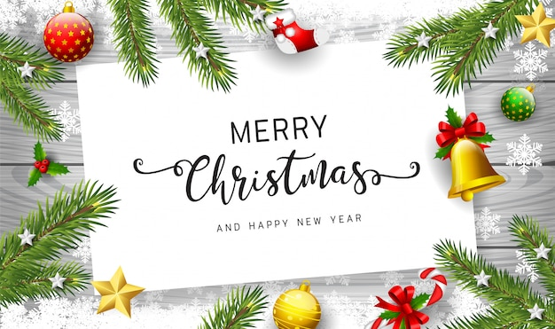 Holiday's background with season wishes and border of realistic looking christmas tree branches decorated