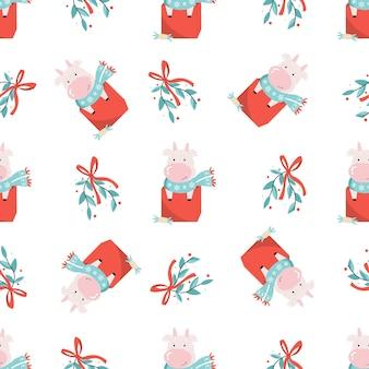 かわいい牛と装飾的な要素を持つ休日のシームレスなパターン。包装紙、ギフトボックス、布地の新年のデザイン。