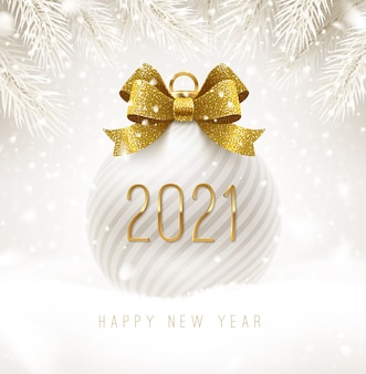 Holiday white bauble with golden bowknot  and   new year greeting. christmas ball on a snow.