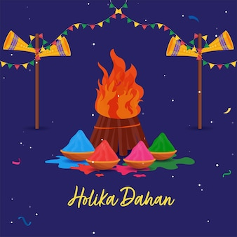 Holika dahan concept with bonfire, color powder (gulal) in bowls