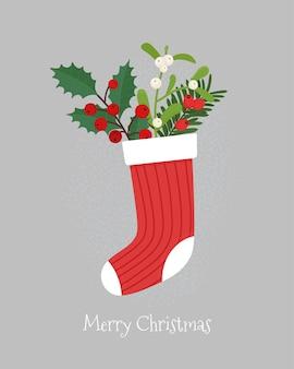 Холли берри и ветка омелы в рождественском носке. симпатичные векторные иллюстрации, шаблон поздравительной открытки