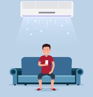 가정용 에어컨, 냉각 기능이 있는 방, 실내 온도 조절 장치가 있는 소파에 앉아 있는 남자.