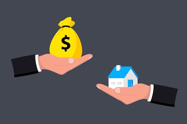 Дом и деньги под рукой. деньги и дом. покупка дома. концепция купли-продажи. сделка купли-продажи