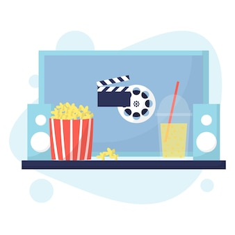 ホームシネマのコンセプト自宅で映画を見るポップコーンと飲み物を使った映画の夜フラットスタイル