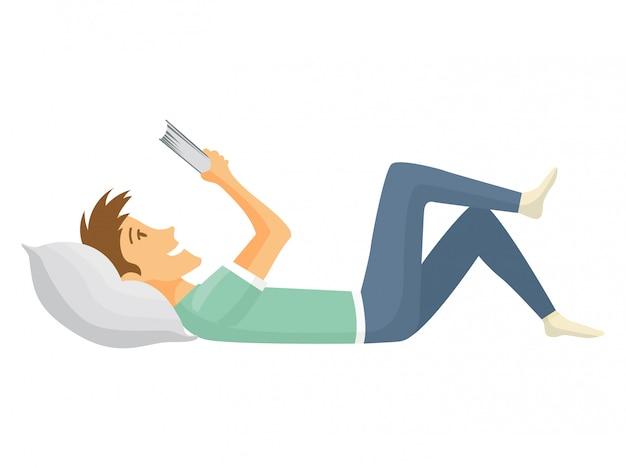 Домашний досуг. мальчик лежал и читал книгу. свободное время молодежи. оставаться дома