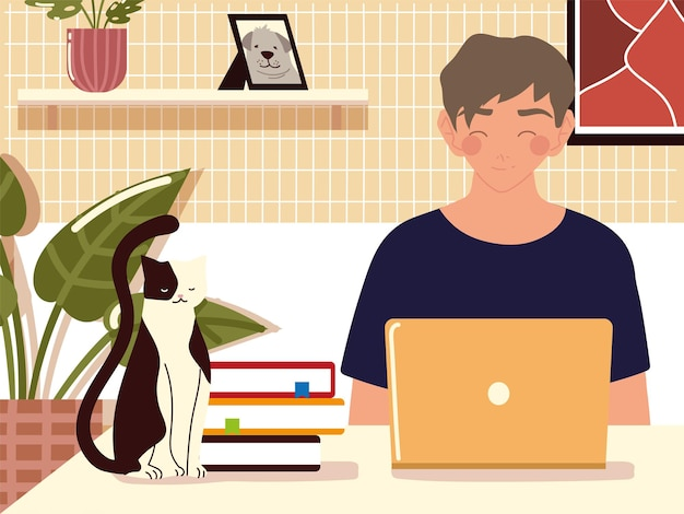 Home working, young man using laptop books and cat on desk