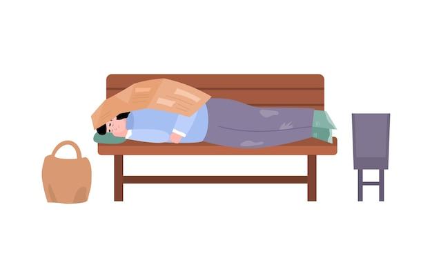 街の通りのベンチで寝ているホームレスの貧しい汚い男