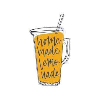 Homemade lemonade inscription or phrase handwritten with elegant cursive calligraphic font on jug or pitcher