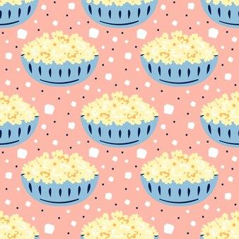 작은 귀여운 파란색 그릇에 만든 팝콘입니다. 플랫 만화 화려한 손으로 그려진 된 완벽 한 패턴