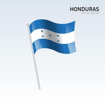 온두라스 회색에 고립 된 깃발을 흔들며