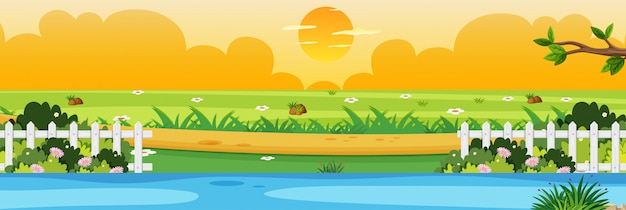 Horizon nature scene or landscape countryside with part of fence riverside view and yellow sunset sky view